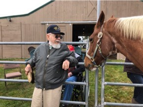 A Maine Veterans' Homes resident visits with a horse